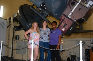 Dr. Kat Barger, Jacqueline Antwi-Danso (TCU) and Madeline Horn (REU). They are at McDonald Observatory in front of the 2.1 meter telescope. This trip to McDonald was part of an REU trip this  summer. The students learned how to make astronomical measurements the telescope. A graduate student also accompanied them and used the telescope for observations for her research.